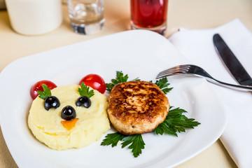 Restourant serving dish for child`s menu - potato puree, cutlet