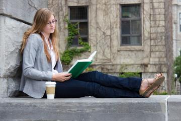 Pretty girl reading her book