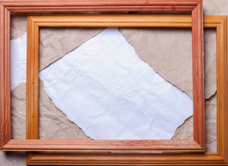 Crumpled paper, place for text and two wooden frames