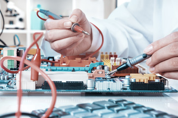 Electronics repair service, closeup on hands