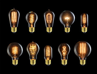 Set of vintage glowing bulb on black