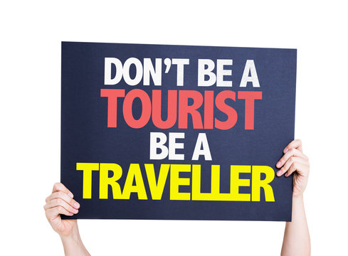 Don't be a Tourist Be a Traveller card isolated on white