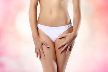 woman abdomen on pink background