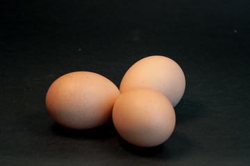 Three eggs on the black background