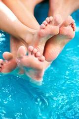 People feet relaxing in jacuzzi.