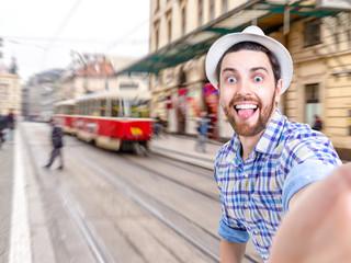 Happy young man taking a selfie photo in Prague, Czech Republic
