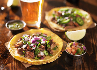 Wall Mural - authentic mexican tacos with beer on wooden table