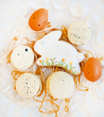 easter eggs and cookies on a white background