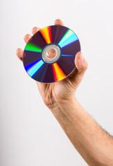 Hand Holding DVD CD Disc Against White Background