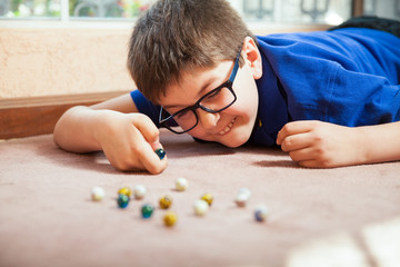 Kid playing with marbles
