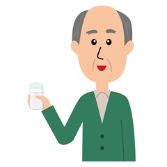 A happy elderly man with a glass of milk in his hand