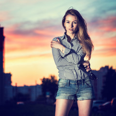 Portrait of Beautiful Girl in Evening City
