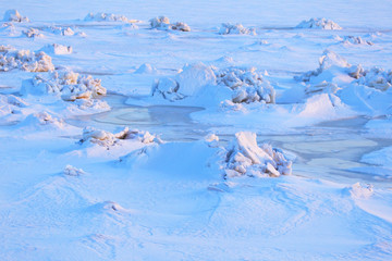 Texture of snow.Ice hummocks. Abstract background of winter.