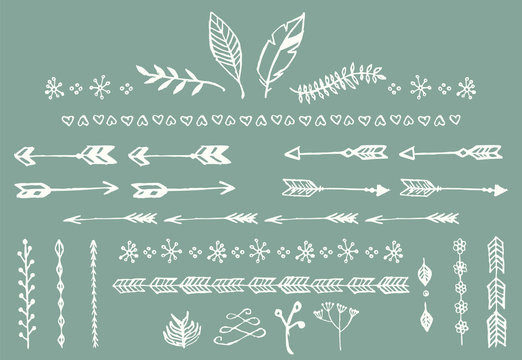 Hand drawn vintage arrows, feathers, dividers and floral