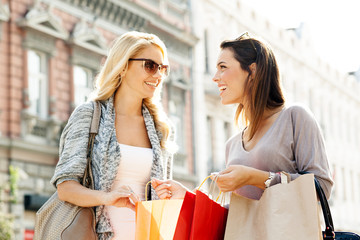 Two women enjoy shopping
