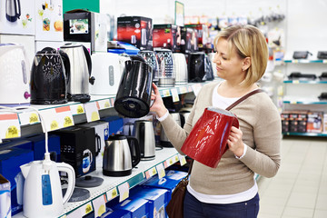 Woman housewife shopping for electric kettle