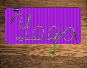 yoga lettering on mat