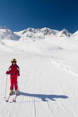 Happy girl skier on a ski slope