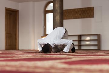 Young African Guy Praying