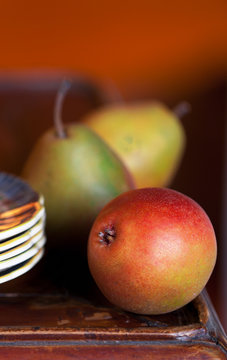 Pears close up. Vintage plates and old wood table