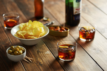 Vermouth glasses with appetizers