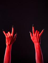 Red spooky hands showing heavy metal gesture