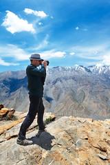 photographer tourist in mountains