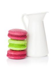 Colorful macarons and milk jug