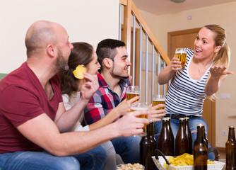 Happy people drinking beer indoor
