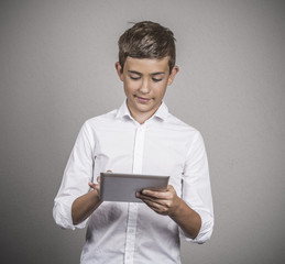 Teenager boy holding portable pc browsing internet
