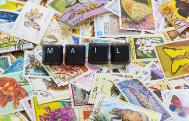 words on cubes against the background of the old postal stamps