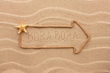Arrow made of rope and sea shells with the word Bora Bora on the