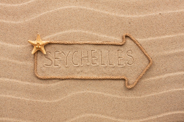 Arrow made of rope and sea shells with the word Seychelles on th