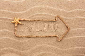 Arrow made of rope and sea shells with the word Thailand on the