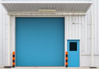Shutter door and steel door outside factory, blue color.