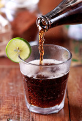 pouring cola to a glass