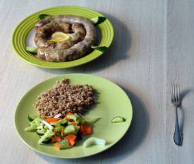 homemade pork sausage served with garnish of boiled buckwheat wi