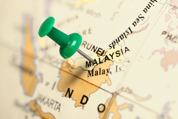 Location Malaysia. Green pin on the map. Wall mural