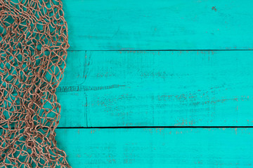 Blank teal blue sign with fish net border