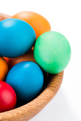 easter eggs and wooden plate isolated on white