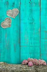 Hearts hanging on fence with log and floral border