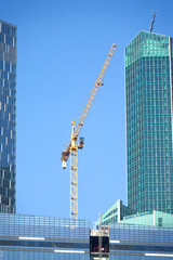 Tower crane on top of construction office skyscraper buildings