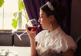 young beautiful woman in bar with red wine
