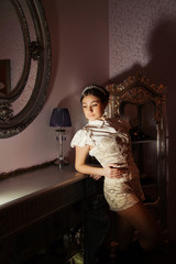 young pretty woman in interior. Fashion dark light
