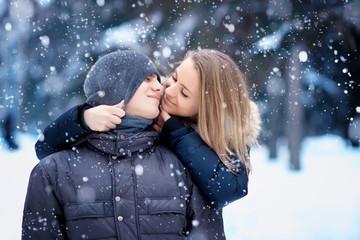 Happy Couple Having Fun Outdoors. Snow. Winter Vacation. Outdoor