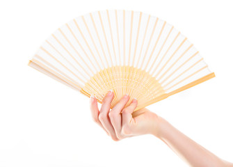 Wood elegance fan in woman hand isolated on white background