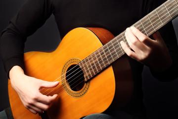 Acoustic guitar close up hands