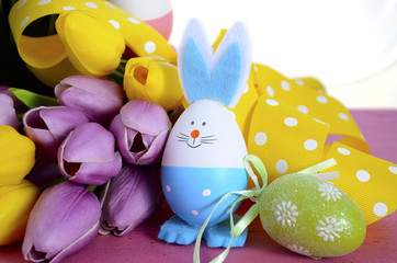 Happy Easter egg hunt baskets with tulip flowers