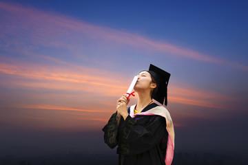 Beautiful female graduate wearing a graduation gown
