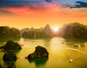 Halong Bay in sunset, Vietnam. Unesco World Heritage Site.